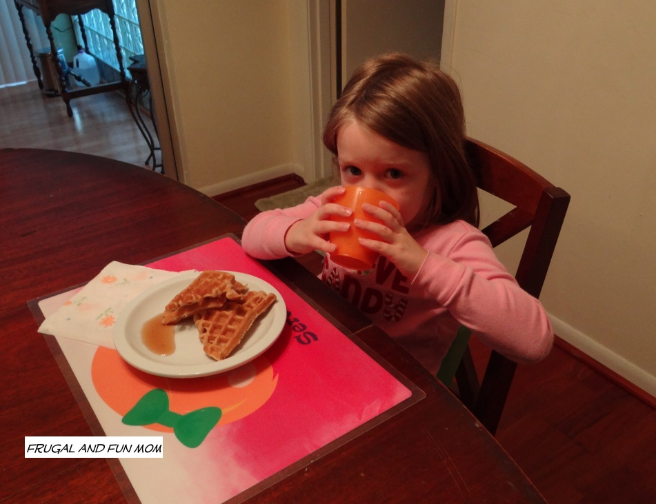 little girl eating breakfast with Silk Fruit and Protein