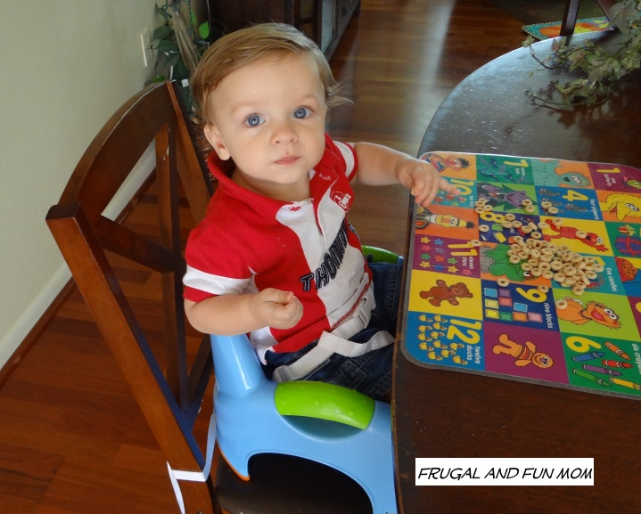 Baby in Nuby Booster Seat