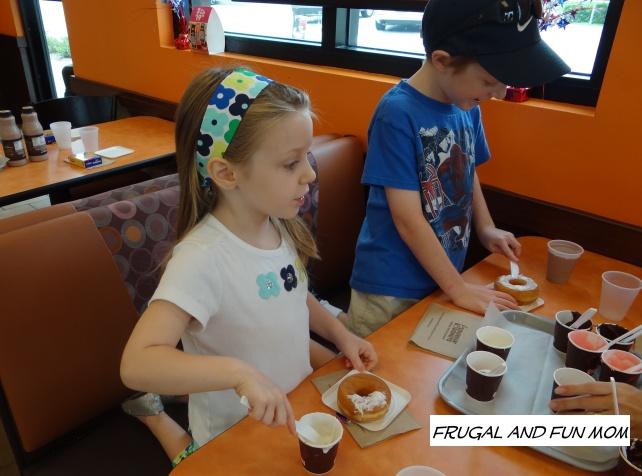Kids decorating donuts