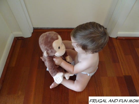 Baby with Curious George Kohl's Cares Doll