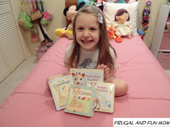 Daughter with Sophie la girafe books
