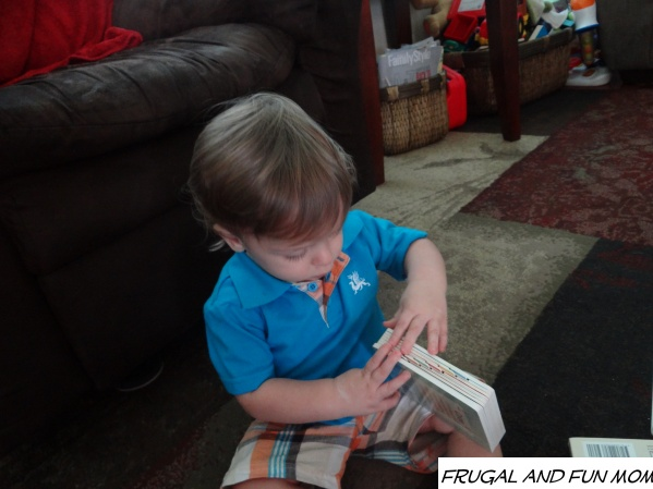 baby with Sophie la girafe book
