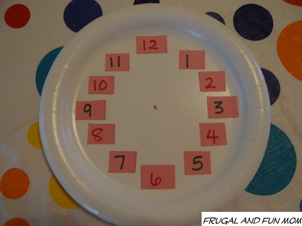 Clock Craft Made With Paper Plate Numbers on Plate