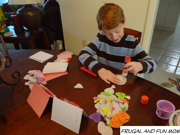 Pasting doilies onto Homemade Vantines Day Card from Oriental Trading