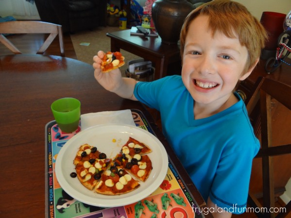 Eating pizzas made with Frigo Cheese Heads Light String