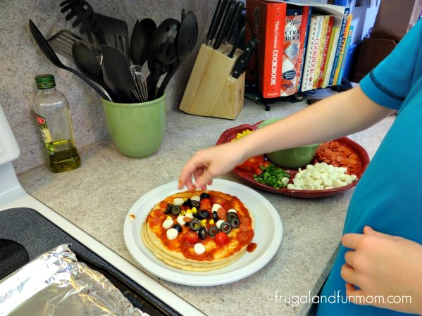 Making Pizzas made with Frigo Cheese Heads Light String