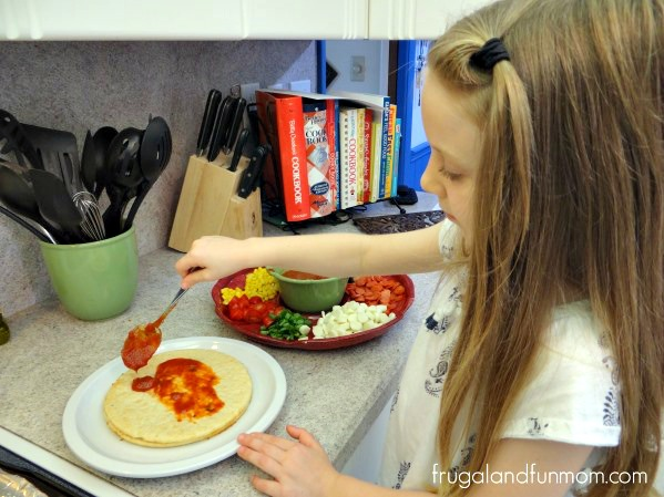 Pizzas made with Frigo Cheese Heads Light String and sauce