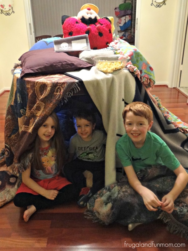 Building a pillow fort with and Pop Secret