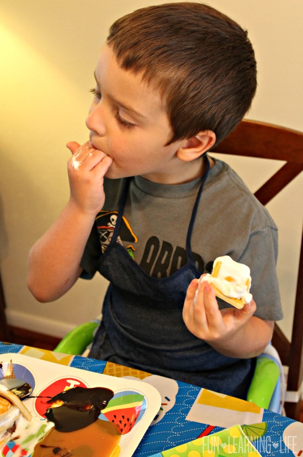 enjoying the cookie stacking game with Pepperidge Farms Chessmen cookies, Smucker's Simple Delight toppings and Reddi-wip