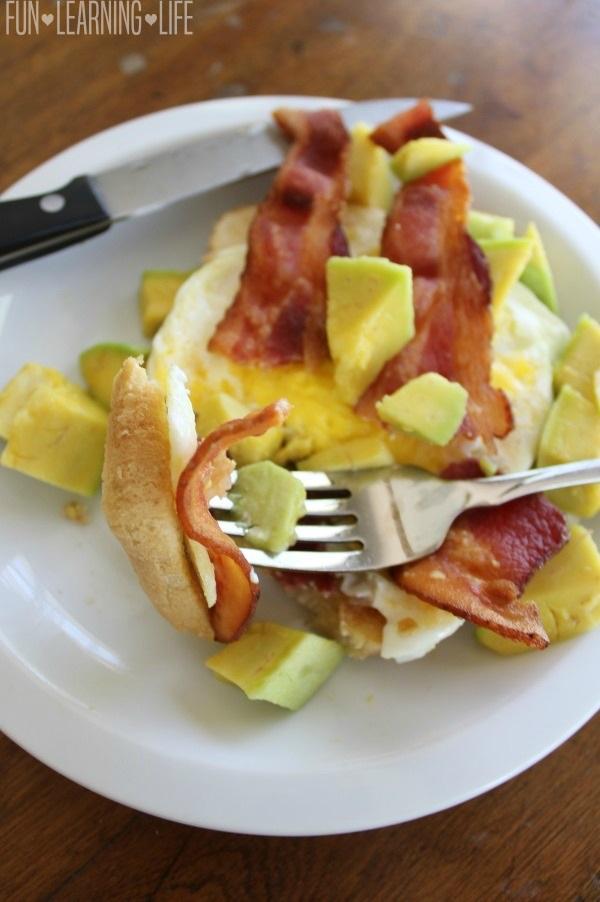 Bacon Egg and Avocado Open Faced Breakfast Sandwich on Fork
