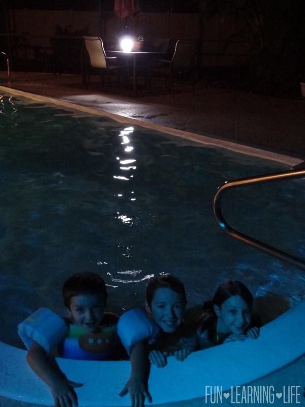 Lighting up Night Time Pool Time Energizer® Fusion LED Folding Lantern