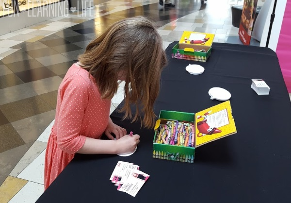 Filling out her dream card at the Barbie Event