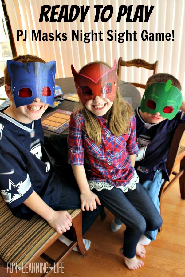 kids-wearing-masks-to-play-pj-masks-night-sight-game-from-wonder-forge