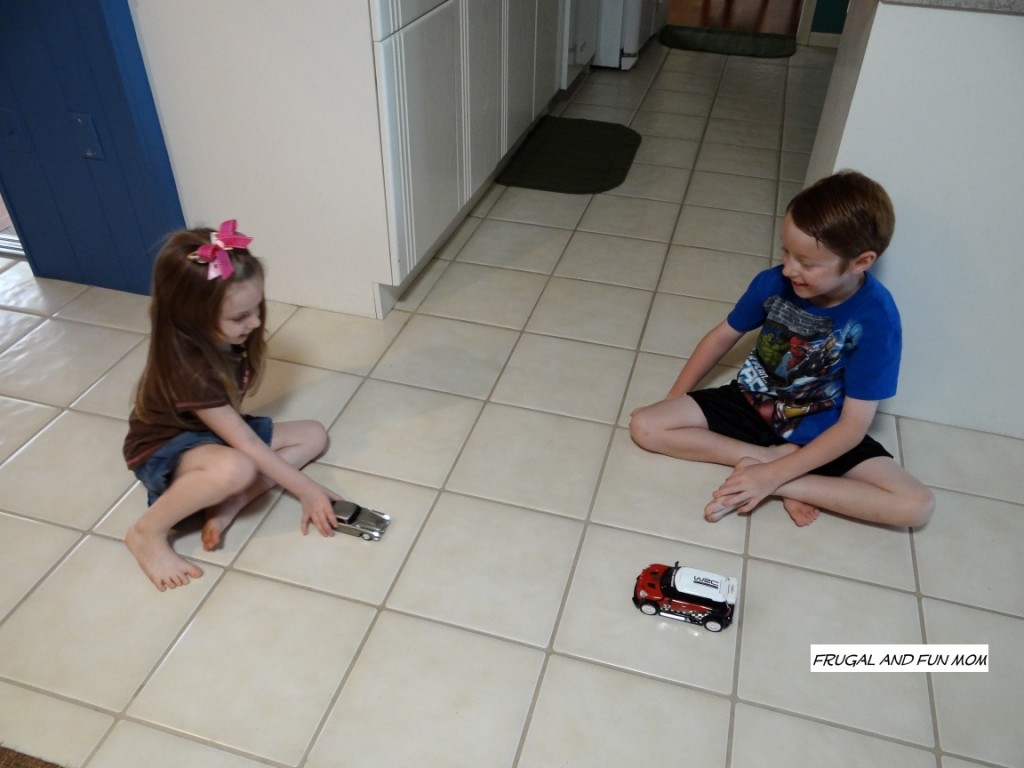 Kids playing with 007 Car