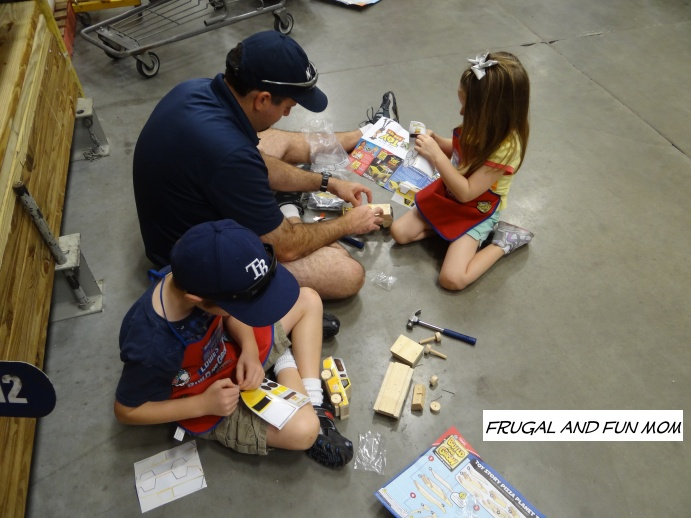 Kids with their Dad at the Lowe's Buld and Grow