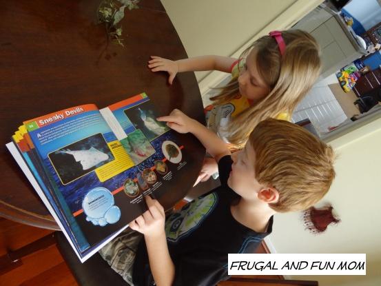 Kids reading Sharkopedia