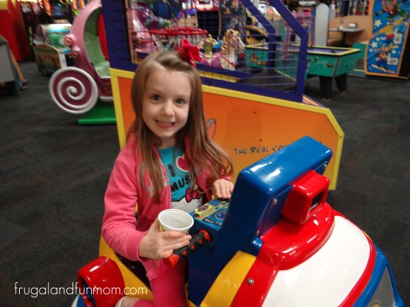 Riding a ride at Chuck E Cheese