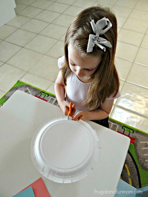 Cutting the paper plate