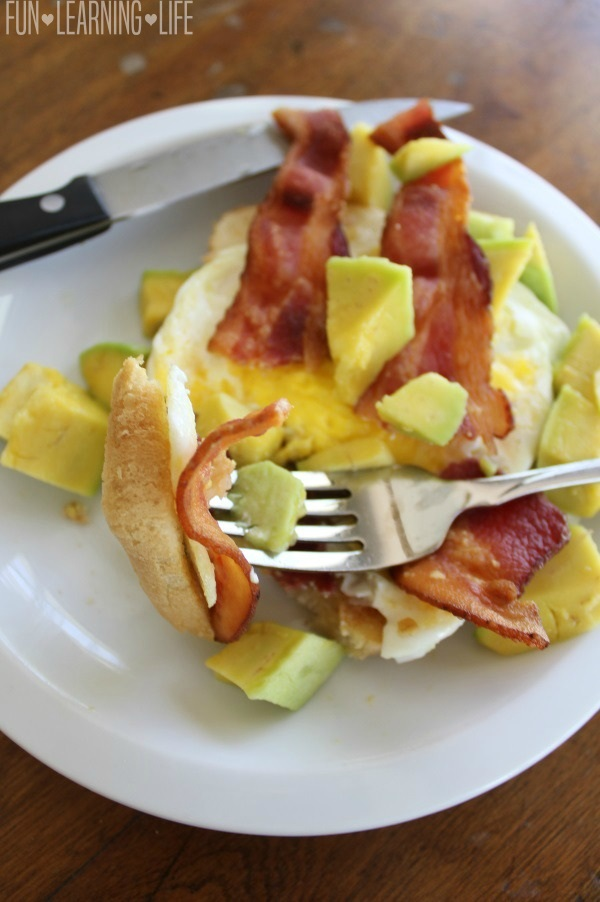 Bacon Egg and Avocado Open Faced Breakfast Sandwich on Fork