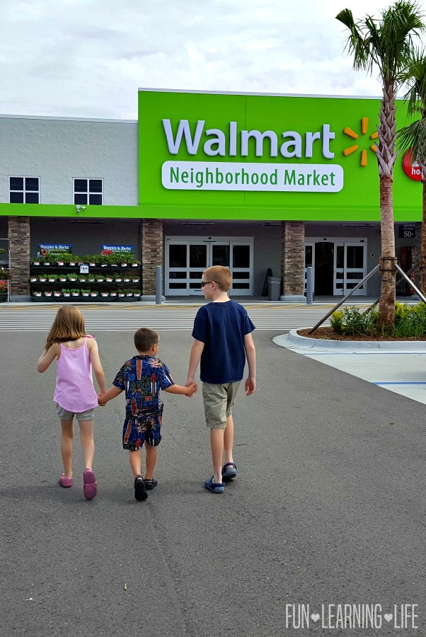 Siblings walking into Walmart Neighbrhood Market to get Pull-Ups