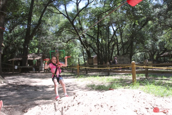 Zip lining on children's course at Tree to Tree Adventures