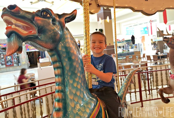 riding-the-carousel-at-westfield-sarasota-square-mall